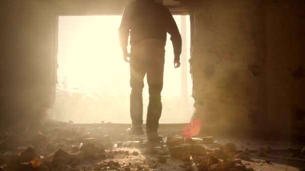 Man Walking in Abandoned Building