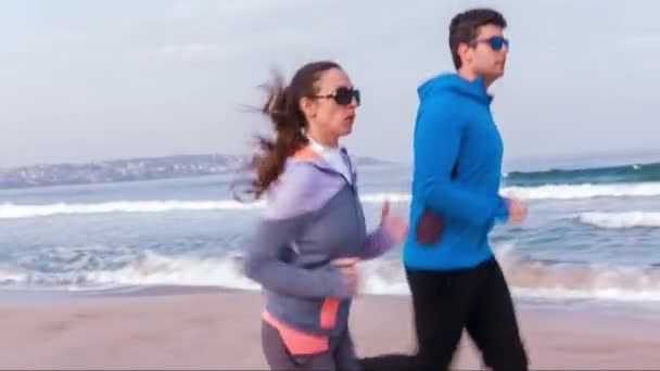 Pretty Young Couple Man Woman Running Jogging Beach Vacation Summer Exercise Fitness Healthy Lifestyle Recreation Happy Fitness Youth