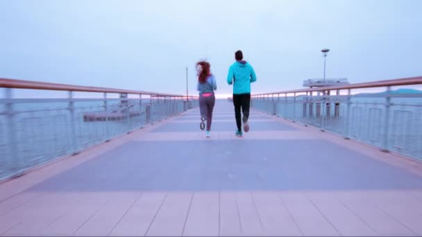 Couple Runners Joggers Running Sea Vacation Pier Early Morning Sunrise Clouds Active Healthy Lifestyle Outdoor Training Workout