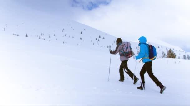 couple trekking in mountain