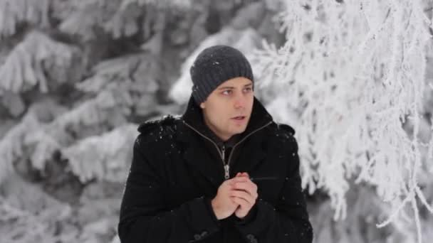 Man freezing in winter forest