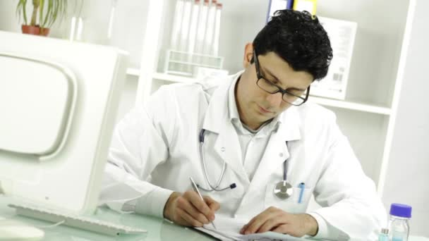 Doctor signing and handing RX prescription