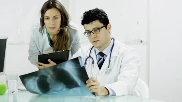 Doctor and nurse examining Xray