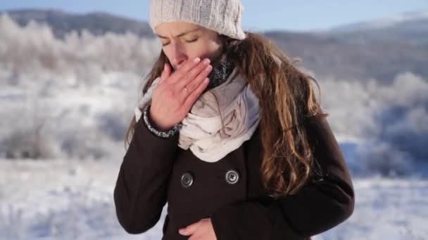 Young woman coughing flu