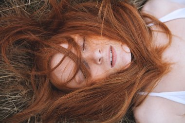Beauty Young Woman with Red Hair. Close-up