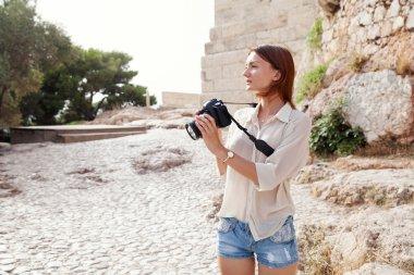 The tourist near the Acropolis of Athens, Greece