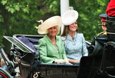 KATE MIDDLETON, LONDON, UK - JUNE 13: Kate Middleton and Camilla Rosemary seat on the Coach at Queen's Birthday Parade, also known as Trooping the Colour ceremony, on June 13, 2015 in London, England, UK