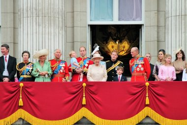 QUEEN ELIZABTH & ROYAL FAMILY, LONDON, UK - JUNE 13: The Royal Family appears on Buckingham Palace balcony during Trooping the Colour ceremony, also Prince Georges first appearance on balcony, on June 13, 2015 in London
