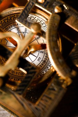 Old compas in brass sun clock