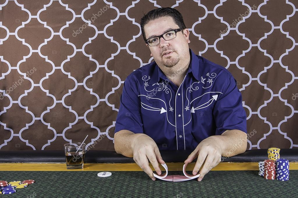 A man playing poker sitting at a table — Stock Photo