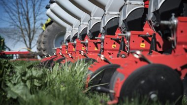 Agricultural machinery on green grass