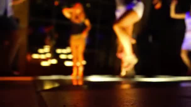 Dance floor in a disco club with people dancing with defocused background