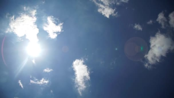 Timelapse movie of hot sun background with clouds and flare