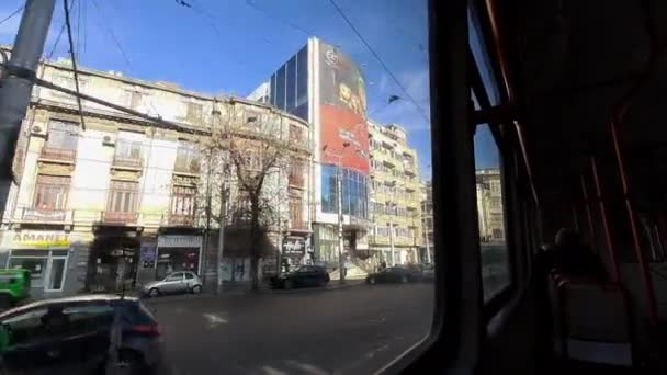 Bucharest, Romania - November 19, 2020: View of the Carol Boulevard from a an old Romanian V3A tram, in Bucharest.