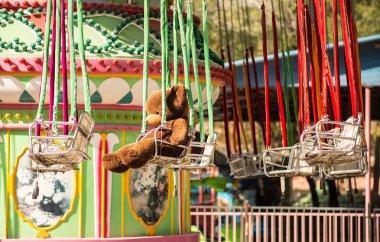 plush animals ride on the carousel