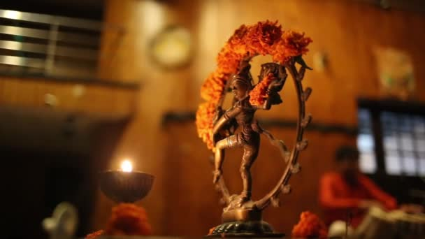 Statue of Shiva, incense and candles
