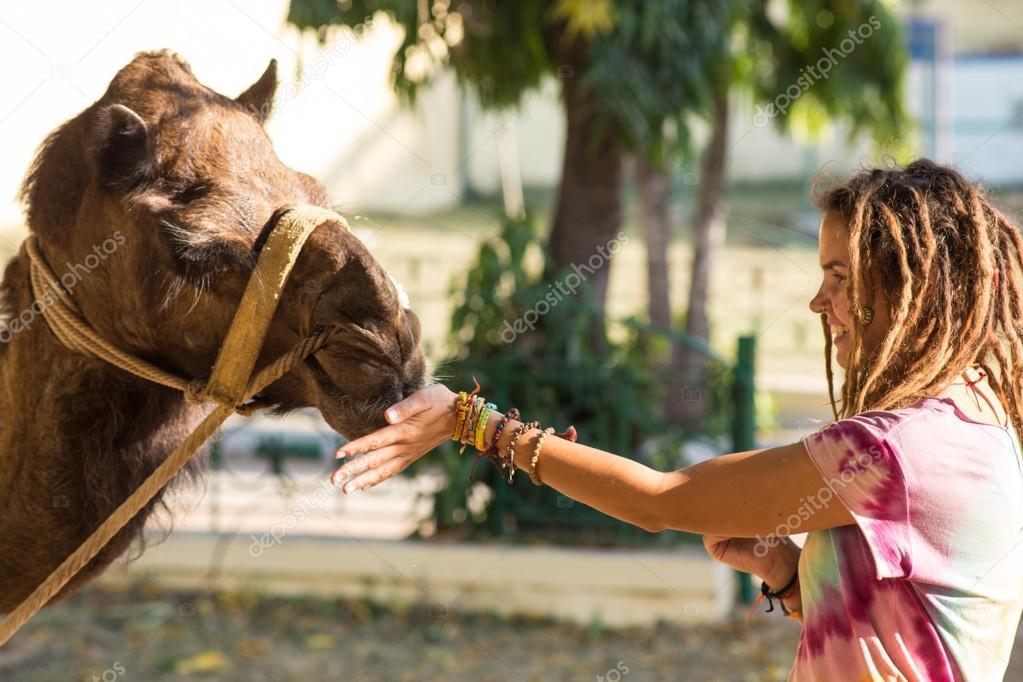 Tourists children riding camel