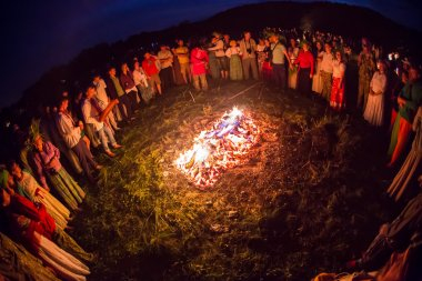 People celebrate the holiday and Russian dance in a circle around  sacred fire