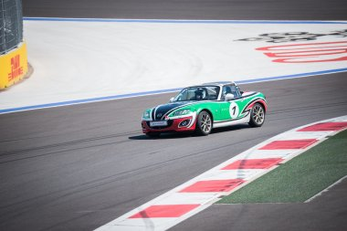 Training races of the Mazda racing car on the autodrom.