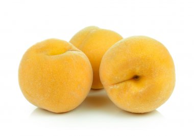 ripe yellow peach on white background