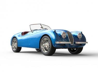 Bright blue vintage car on white background