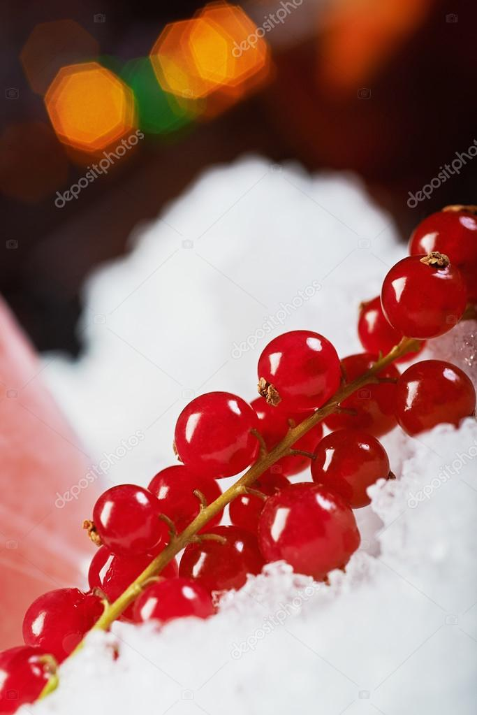 color and beautiful decoration for a cocktail at the bar: ice and fresh bright berries on a table with a nice bokeh and party atmosphere. soft focus