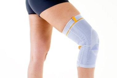 Woman Wearing Flexible Knee Brace