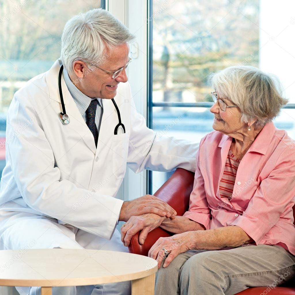 Elderly woman in consultation with her doctor.