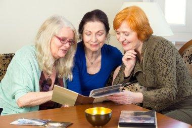 Women Looking at Photo Album