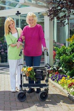 Nurse Holding Arm of Senior Woman