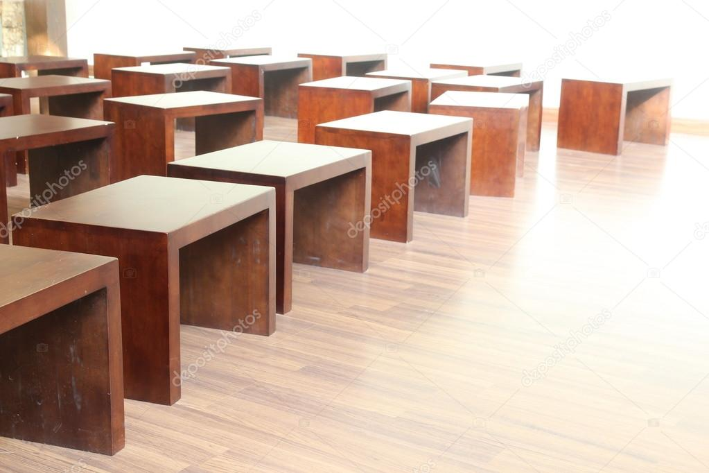 many wood chair in room