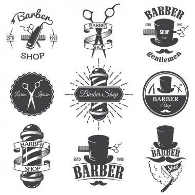 Set of vintage barber shop emblems
