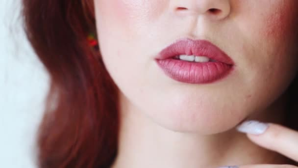Lips with lipstick of beautiful young woman. Close up view