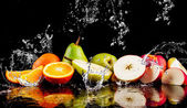 Fotografie Pears, apples, orange  fruits and Splashing water