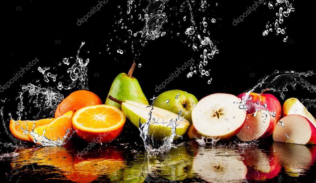 Pears, apples, orange  fruits and Splashing water