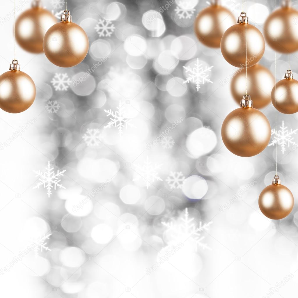 Christmas Ornaments Background.Golden Christmas Ornaments On A Silver Background With