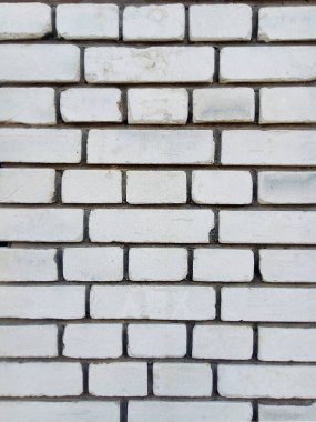white brick wall with gray grout, vertical background texture pattern