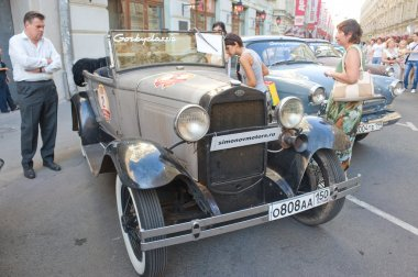 Soviet retro car GAZ-A (licensed copy Ford-A) for retro rally Gorkyclassic in the Parking lot near Gum Department store, Moscow, front view