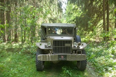 American old military Dodge WC-51 on retro rally in the woods, 3rd international meeting