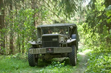 Army American car Dodge WC-51 on retro rally in the woods, 3rd international meeting