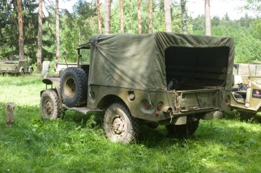 American old army retro car Dodge WC-51 on retro rally in the woods, 3rd international meeting