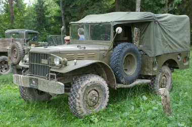 American military passenger car Dodge WC-51 on retro rally in the woods, 3rd international meeting