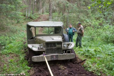 Old military retro car Dodge WC-51 stuck in the woods, 3rd international meeting