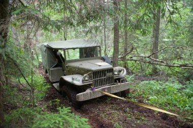 American military retro car Dodge WC-51 stuck in the woods on a heavy road, 3rd international meeting