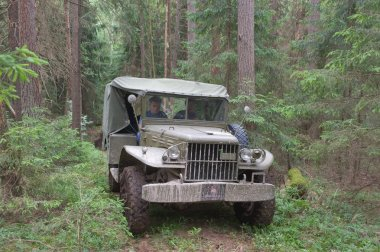 American car Dodge WC-51 in the woods on a heavy road, 3rd international meeting