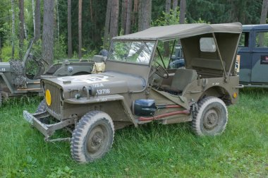 Retro car Willys MB in the forest at the 3rd international meeting of