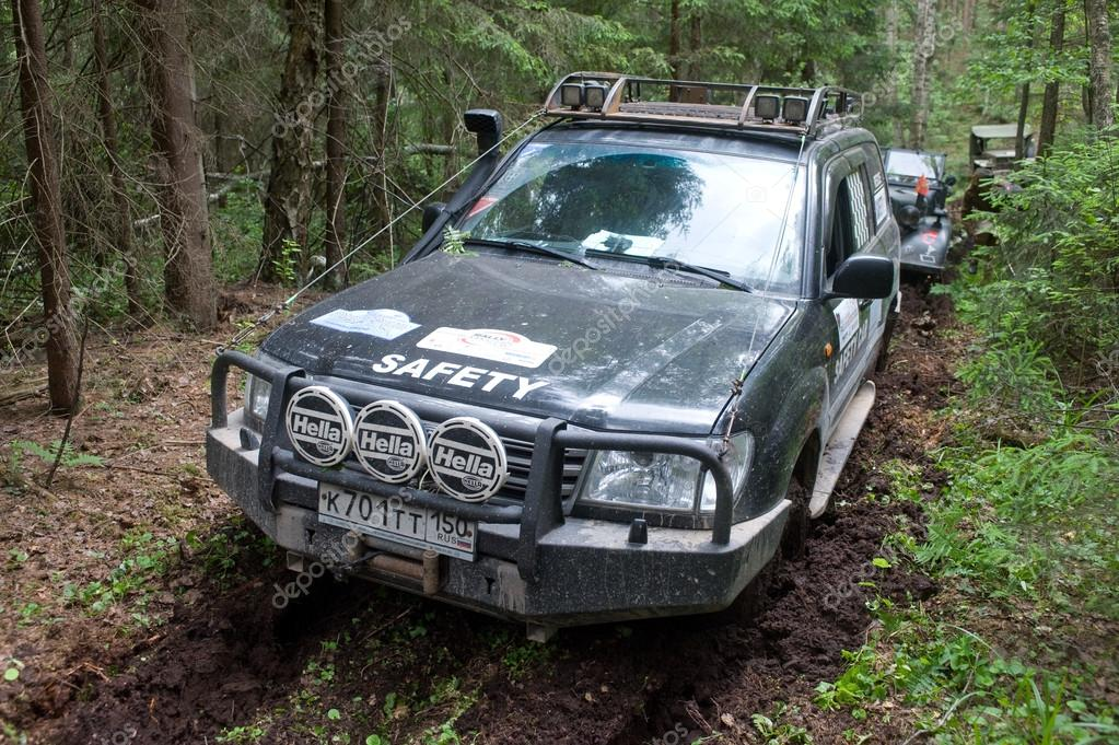 Off-road vehicle Toyota Land Cruiser stuck in the woods, 3rd international meeting
