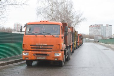All of the trucks on Vyasa in snow melting point, Moscow