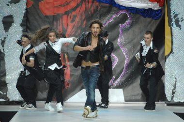 Moscow Fashion Week in Gostiny Dvor. Russian singer Dima Bilan with the dancers on the show designer Ilya Shiyan