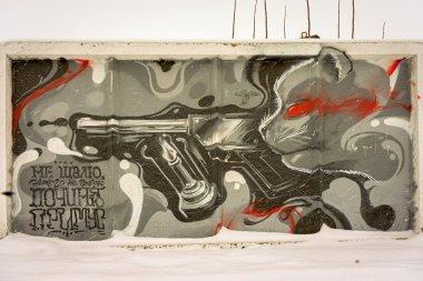 NOVOSIBIRSK, RUSSIA - MARCH 01, 2016: Cat Behemoth graffiti with gun and inscription quote
